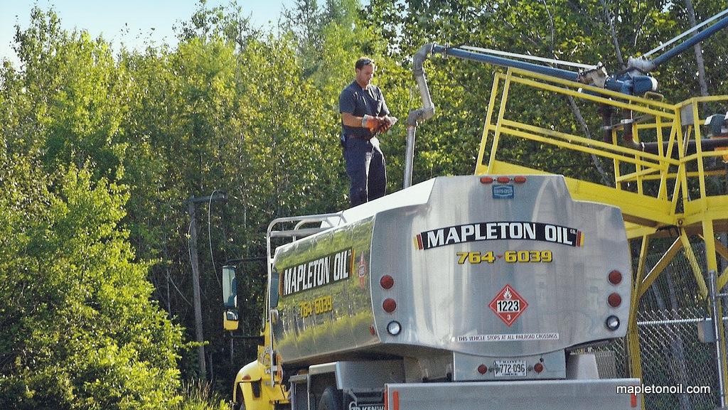 Tim Wood of Mapleton Oil filling fuel truck
